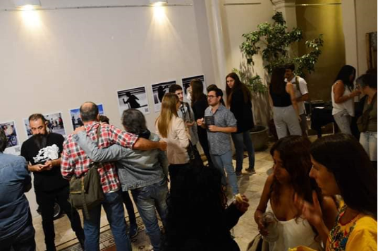 """A group of 20 people attending the inauguration of the accessible photographic exhibition """"We Feel"""" at the MediHome Foundation in the City of La Plata."""